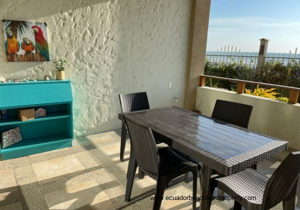Beachfront patio with 6-top dining set