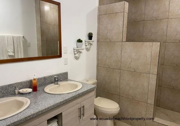 Spacious ensuite bath with double vanity and walk-in shower