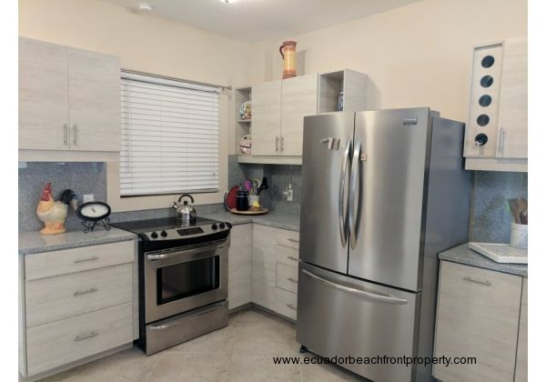 Spacious kitchen comes well-equipped with new stainless appliances
