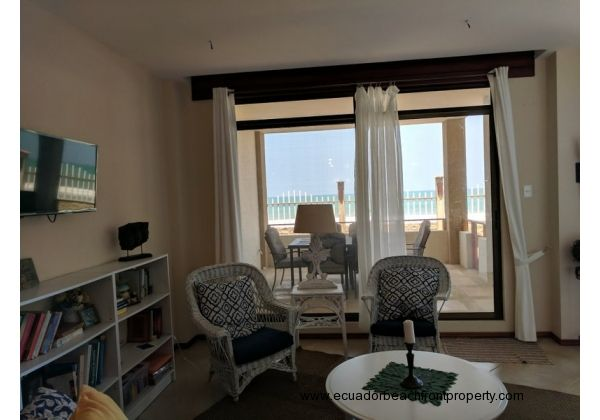Living room looks out to the covered beachfront patio
