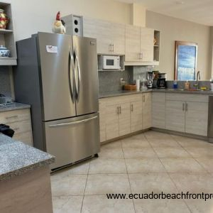 Spacious kitchen comes well-equipped with stainless appliances