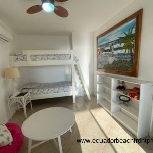 Spacious second bedroom with seating area.