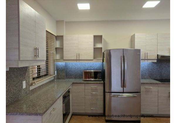 Brand new appliances include refrigerator, induction stove, oven, microwave, dishwasher, washer and dryer