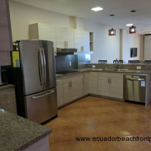 Spacious kitchen equipped with stainless appliances