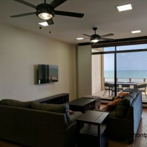 Living area with beachfront balcony