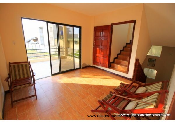 access to the terrace and stairs to the third floor,