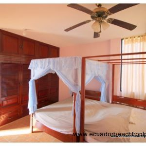 junior master bedroom with built in cabinets
