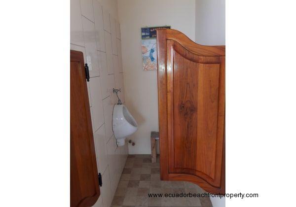 Urinal room with swinging saloon doors