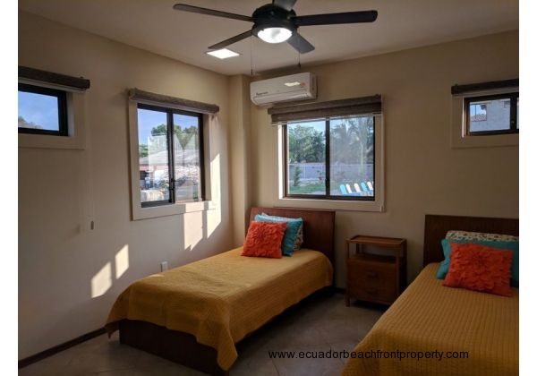 Second bedroom with twin beds and AC