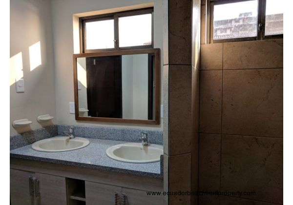 Master bath with double sinks and walk-in shower