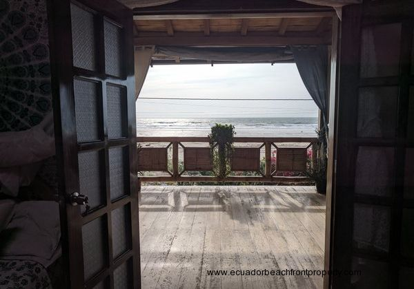 Double doors from bedroom 3 with stunning ocean views