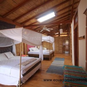 Large bedroom with 2 queen beds, sitting area, and ensuite bath that is currently used as a holiday rental