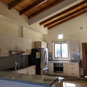 Kitchen is equipped with appliances including a large refrigerator with ice maker, oven, 5-burner stovetop, and dishwasher