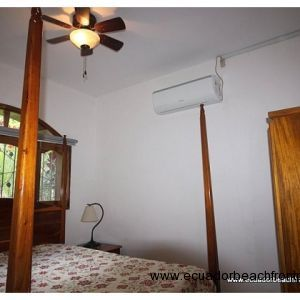 Second bedroom has a double bed, AC and overhead fan