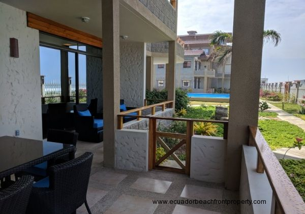 Oceanfront porch with access to pool and beach