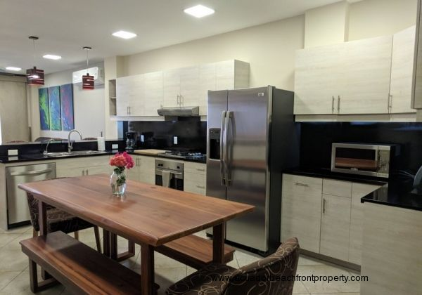 Kitchen with stainless appliances and custom wood dining table
