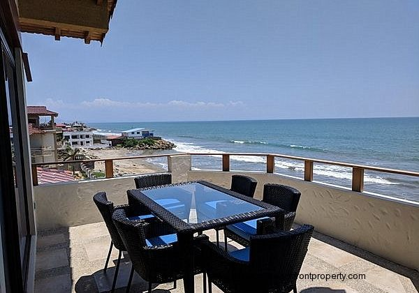 Oceanfront porch has a dining table for 6