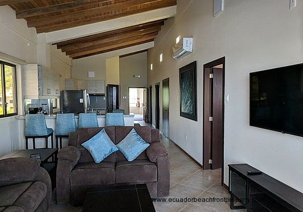 Spacious, well equipped beachfront condo with vaulted wood ceilings