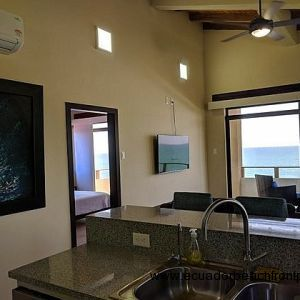 Oceanview kitchen with double sinks, dishwasher, stove, oven, large capacity refrigerator with ice maker