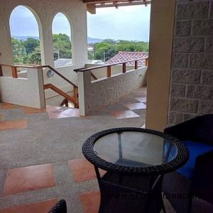 Private seating area at the front entrance to the penthouse with beautiful views of the hills