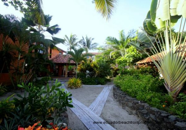 Tropical landscaping and bamboo pathways separating the the main house from the guest house