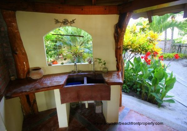 Outdoor kitchen overlooks the tropical gardens