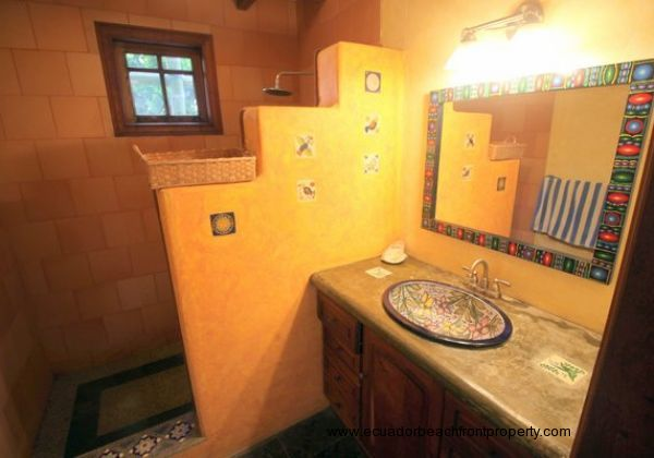 Downstairs shared bath with custom ceramic sink and walk-in shower