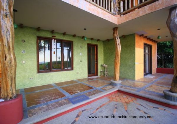 Textured stucco walls, rustic wood features, and tile mosaics are some of the many artistic elements found throughout the property