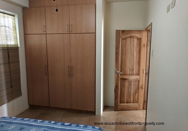 master bedroom with closet and ensuite bath