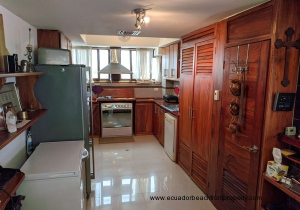 Kitchen is complete with large fridge, separate deep freezer, gas stove/oven, dishwasher, hood vent, and small appliances.