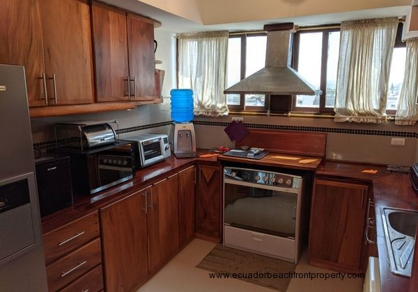Well-equipped kitchen with wood cabinetry