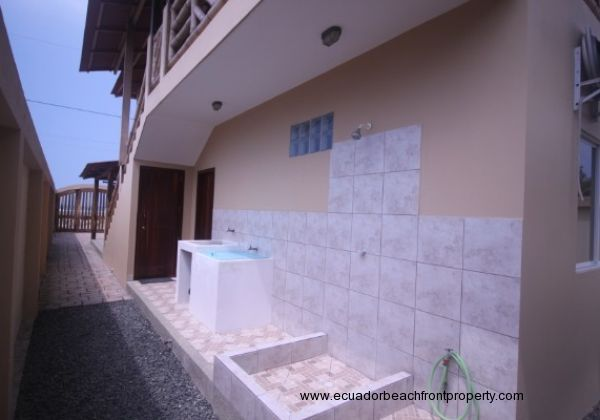 Outdoor sink and shower with storage under staircase - Edited