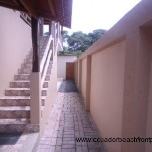 staircase and brick sidewalk to bodega