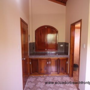 Bonus room bar with granite countertop and cabinetry - Edited