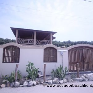 House of Three Arches exterior with cactus