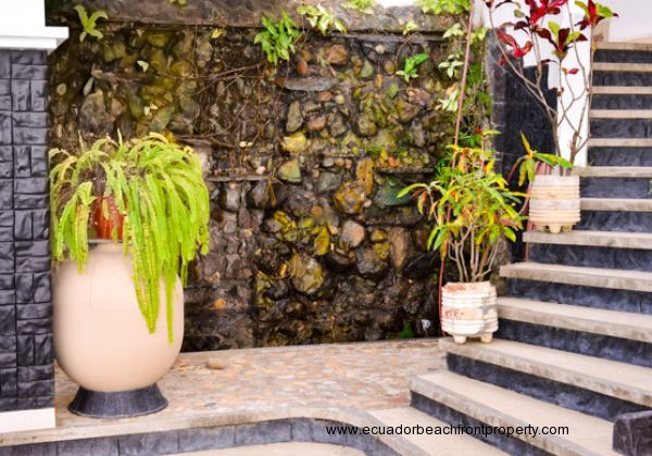 Decorative wall garden on the pool level going up to the house.