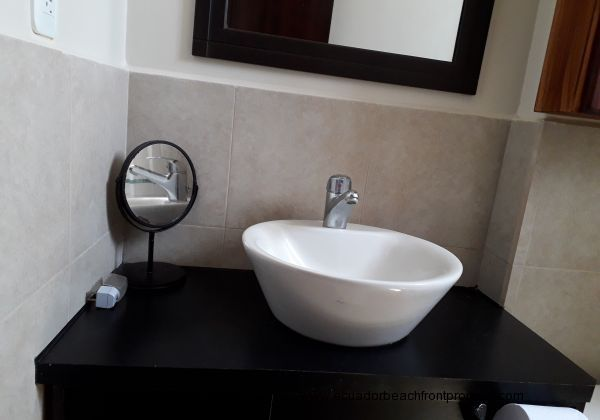 Modern fixtures and fittings in bathrooms.