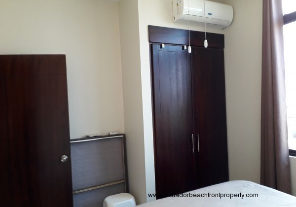 Built-in closet and air conditioning unit in bedroom 2.
