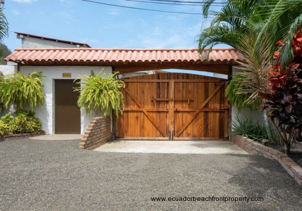 New entrance gate made from wood to keep the theme of this home.
