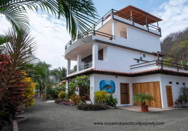 SOLD!! --- Tropical Oasis by the Beach