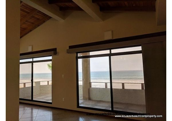 Vaulted wood ceilings and wide open views right to the beach