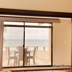 Patio doors out to the balcony that overlooks the beach.