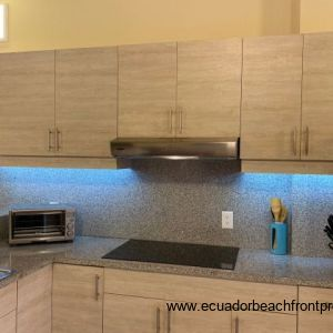 Well spaced kitchen with under counter lighting.