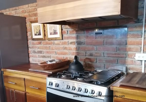 6 burner stove and solid wood counter tops.
