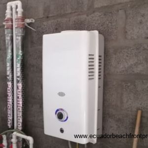On demand water heater, Located in the outside storeroom.