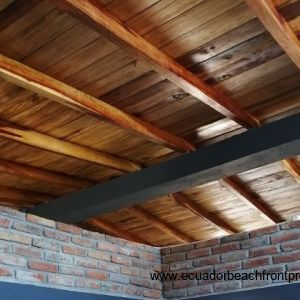 Vaulted ceilings showing off the beautiful wood used throughout.