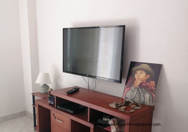 Flatscreen TV and entertainment center