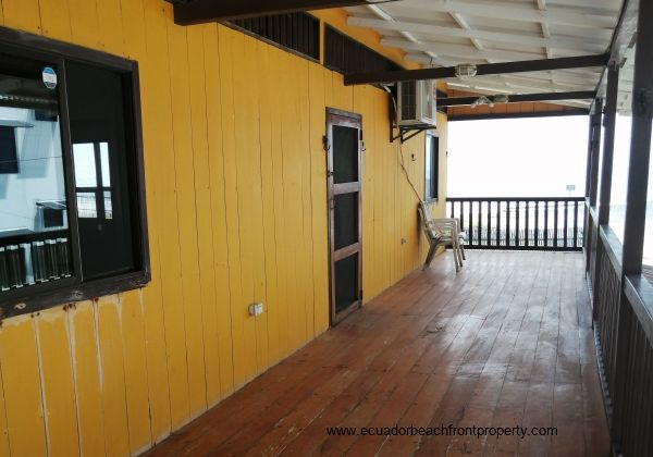 The front balcony and the front door of the main upstairs house.