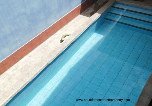 Looking down on the swimming pool from the staircase.