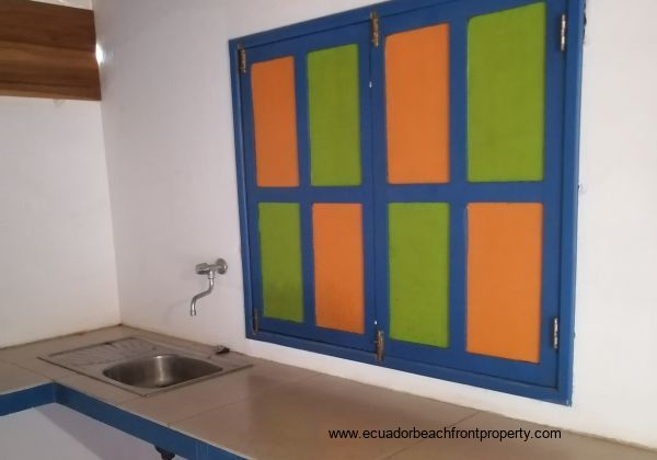 Colorful painted shutters on the windows on the downstair apartment.